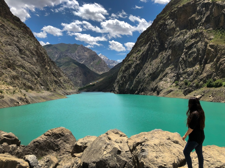 Emerald lake in Tajikistan surrounded by beautiful mountains